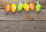 Easter eggs on wooden table background