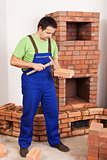 Man building masonry heater