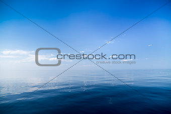 Beautiful sunny day with blue sky over the sea.