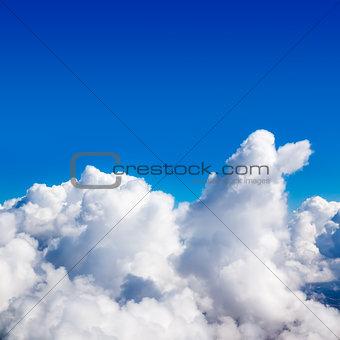 Cumulus clouds in the sky. Sunny day.