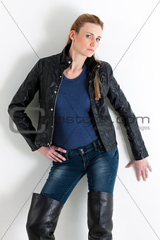 portrait of standing woman wearing jeans and black jacket