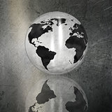 Globe on a grunge brushed metal background