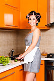 middle-age beautiful woman in the kitchen with knife