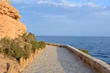 Paved coastal walkway on a summer evening