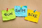 run, bike, swim - triathlon concept