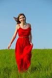 Beautiful girl walking with a red dress