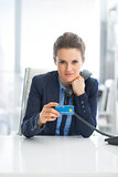 Portrait of business woman holding phone and credit card