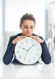 Frustrated business woman with clock