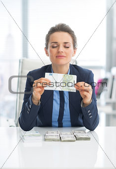 Business woman enjoying having money