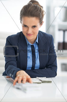 Business woman giving money packs