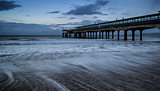 Dawn landscape of pier stretching out into sea