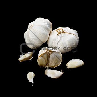 Garlic bulbs on black background