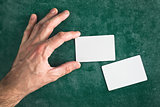 Hand hold blank business card with rounded corners