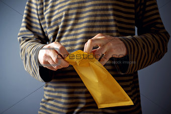 Man opening envelope