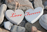 two love hearts on a rocky beach as one