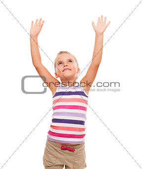 cute little girl standing on white stretching her arms up