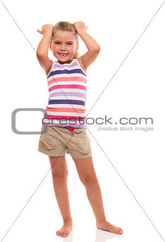 cute little girl standing on white whith hands on her head