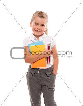 joyful little girl standing on white with few colorful notebooks