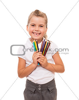 Little girl holding a few colorful pencils on white