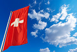 Switzerland Flag in Blue Sky