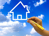 Hand drawing house icon on blue sky.