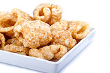Pork rinds on white dish