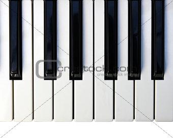 Closeup detail of a piano keyboard.