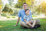 Handsome Mixed Race Father and Son Park Portrait