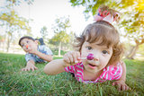 Cute Baby Girl and Brother with Lollipops in Park
