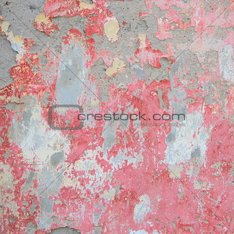 Old wall with red crumbling plaster
