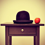 bowler hat and apple, homage to Rene Magritte painting The Son o