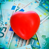 red heart and euro banknotes