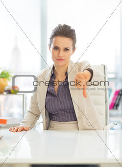 Business woman showing thumbs down