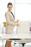 Smiling business woman offering to sit