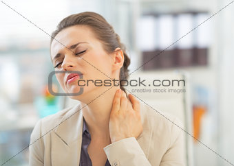 Portrait of business woman with neck ache