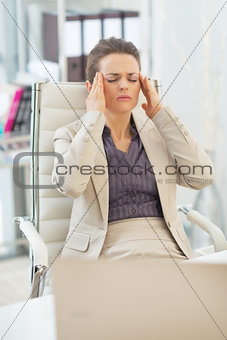 Portrait of business woman with head ache in office