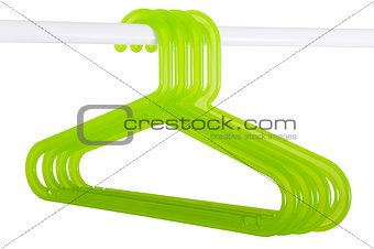 Green hangers on a rod isolated on white