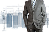 Businessman in suit. Tower crane and skyscrapers