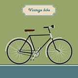 Vintage black bike on modern style background isolated