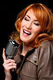 Beautiful redhead woman singing