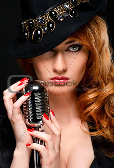 Beautiful redhead girl with retro microphone