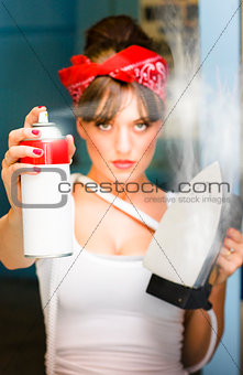 Woman With Iron And Ironing Spray