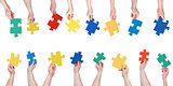 set different puzzle pieces in people hands