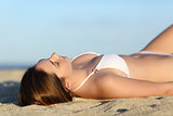 Beautiful woman sunbathing  lying on the beach