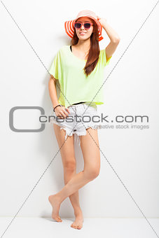 attractive young woman standing on a white background