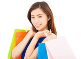 smiling young  asian woman with shopping bags