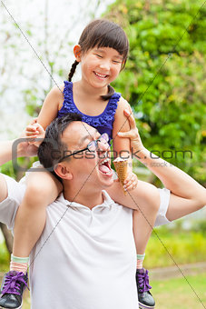 happy little Girl  Eating Ice Cream with father