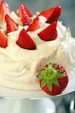 Dessert with lemon cream and ripe strawberries.