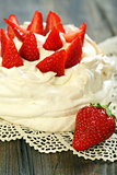 Dessert with whipped cream and strawberries.