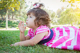 Cute Baby Girl Enjoying Lollipop Outdoors